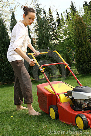 Woman mowing grass