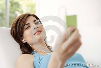Woman with mp4 at Home