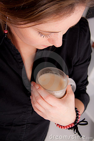 Woman with a muk of hot coffee