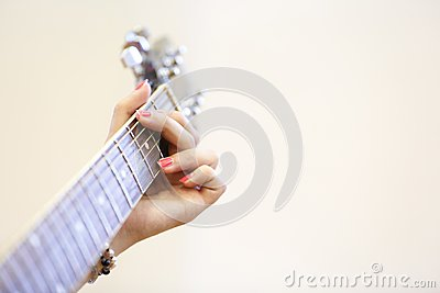 woman musician holding a guitar playing a g chord stock photo image 55529023. Black Bedroom Furniture Sets. Home Design Ideas