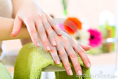 Woman in nail salon receiving nail care
