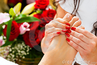 Woman in nail studio receiving foot massage