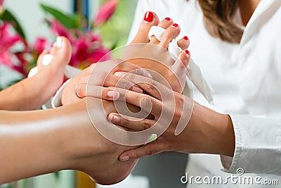 Woman in nail studio receiving pedicure