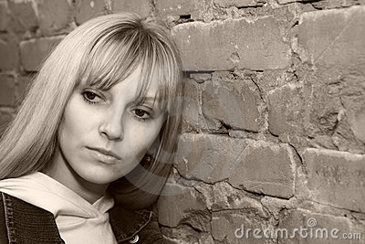 Woman near the brick wall
