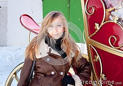 Woman near a coach in a winter park