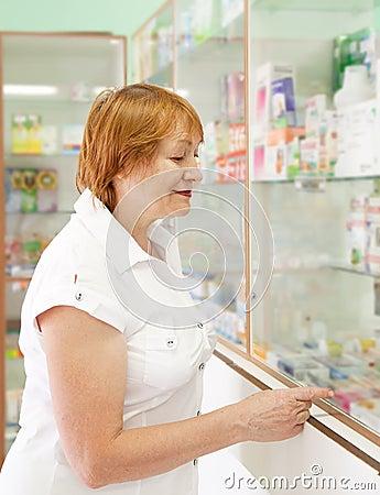 Woman near counter in pharmacy