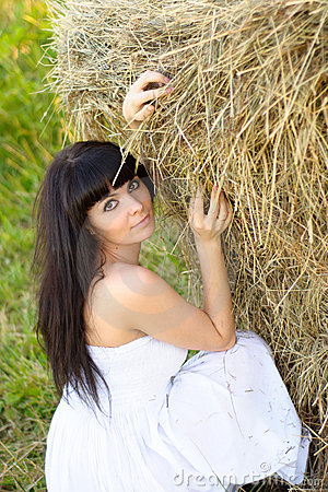 Woman near the haystack.