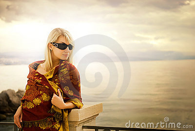 Woman near the ocean at sunset