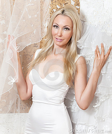woman near to a wedding dress dreams of wedding