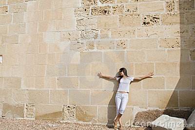 Woman near wall
