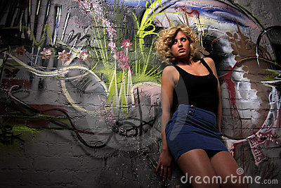 Woman near wall mural