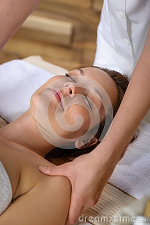 Woman neck massage at luxury spa