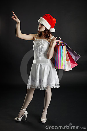 Woman in New Year s cap chooses purchases