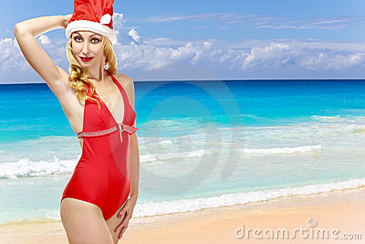 Woman in the New Year s cap walks on a beach