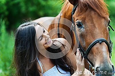 Woman next horse
