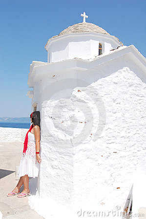 Woman next to the white church, Greece