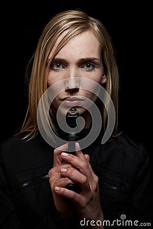 Woman at night with gun