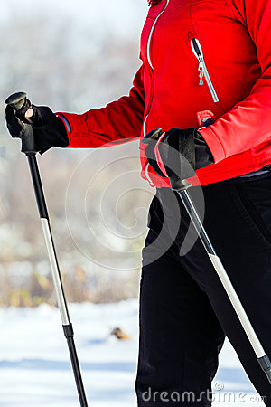 Woman nordic walking in winter, healthy lifestyle