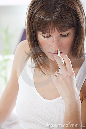 Woman with nose spray