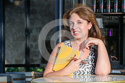 Woman with notebook and pen in the bar