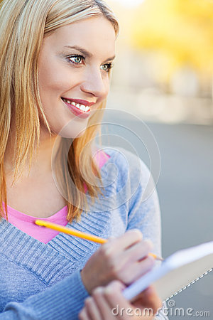 Woman with notebook and pencil