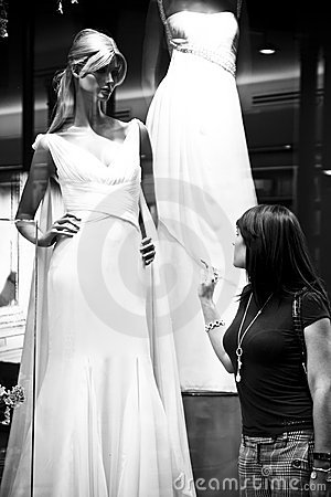 Woman observing beautiful wedding dress