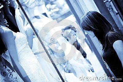 Woman observing beautiful wedding dress
