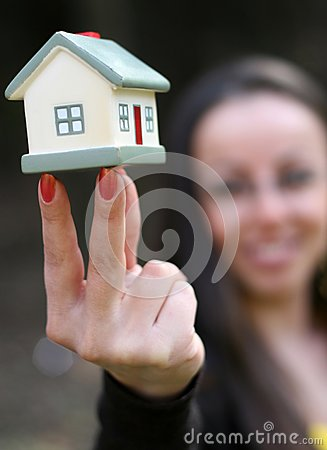 Woman offering a house