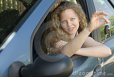 Woman offering keys to her new car