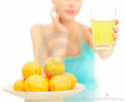 Woman offering orange juice over white background