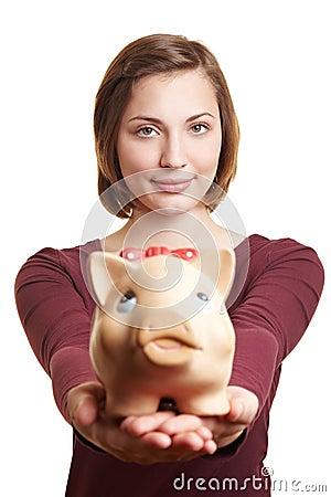 Woman offering piggy bank