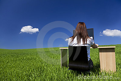 Woman At Office Desk and Computer In Green Field