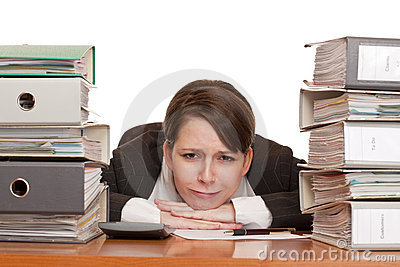 Woman in office with folder stacks is desperate, s