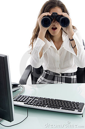 Woman in office and looking through binocular