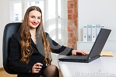 Woman in office sitting on the computer