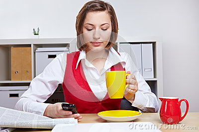 Woman in office taking a break
