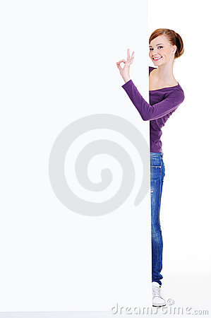 Woman with okay gesture and  advertising billboard