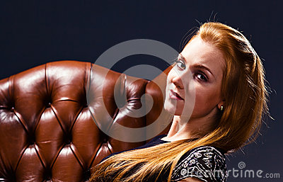 Woman in old leather armchair