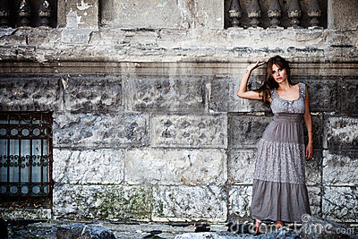 woman by old stone wall  portrait