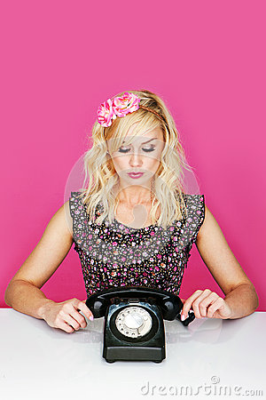 Woman with old telephone