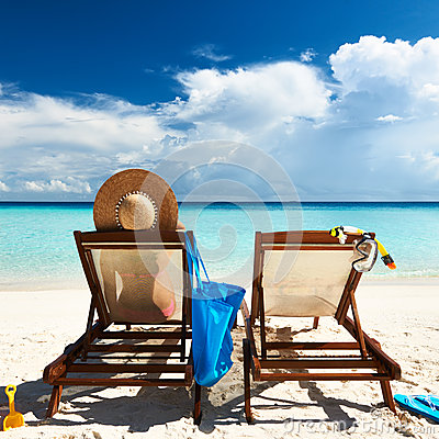 Free Woman On A Tropical Beach In Chaise Lounge Royalty Free Stock Image - 29908406
