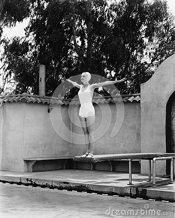 Free Woman On Diving Board At Swimming Pool Royalty Free Stock Photography - 52002277