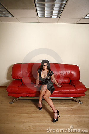Free Woman On Red Couch Royalty Free Stock Photography - 7852767