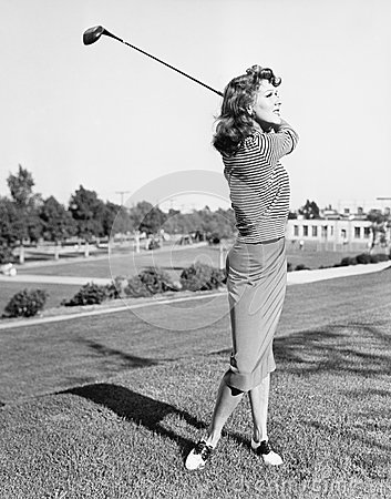 Free Woman On The Driving Range Swinging A Golf Club Stock Photography - 52030292