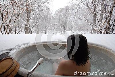 Woman in open air bath