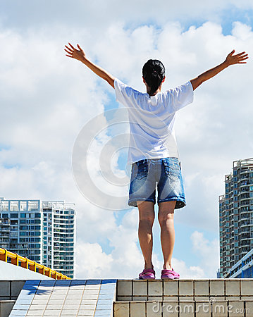 Woman open arms to sky