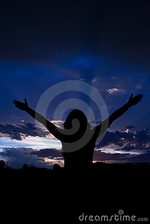 Woman with open hands to clouds sky