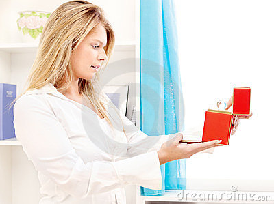 Woman opening fancy box at home