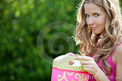 Woman opening a gift