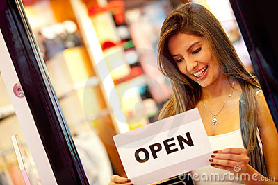 Woman opening a retail store